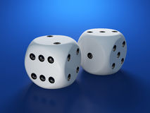 Dices on blue background Stock Images