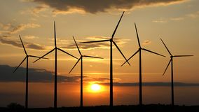 Wind turbines. 3d render of wind turbines on sunset background Royalty Free Stock Photography
