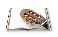 3D render of a wooden classic guitar on opened photobook isolate. D on white background Royalty Free Stock Photos