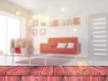 3D wooden table looking out to a defocussed lounge interior. 3D render of a wooden table looking out to a defocussed lounge interior Stock Photos