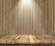 3D wooden table looking out to a wooden wall with spotlight shin. 3D render of a wooden table looking out to a wooden wall with spotlight shining down Stock Photos