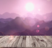 3D render of a wooden table looking to a mountain landscape Royalty Free Stock Photo