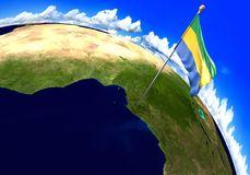 Gabon, national flag marking the country location on world map. 3D render of the world with the location of the country of Gabon marked by its national flag Stock Image