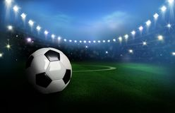 3D Rendered black and white soccer ball on green field in the fo Stock Photos