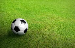 3D Rendered black and white soccer ball on green soccer football Stock Photography