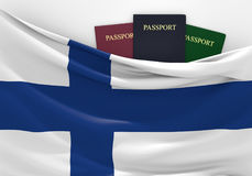 Travel and tourism in Finland, with assorted passports. 3D rendered concept for travel and tourism in Finland, with three assorted passports and the national Stock Photo