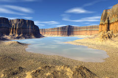 3D rendered fantasy alien planet. Rocks and lake Stock Image