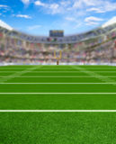 3D Rendered Football Stadium With Copy Space. 3D rendered American football stadium full of fans in the stands with copy space. Deliberate focus on foreground Royalty Free Stock Photos