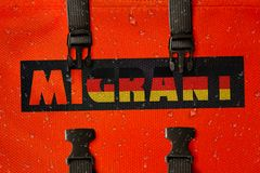 3D rendered idea for migrants crossing the Mediterranean and gaining access into Germany. 3D rendered orange lifejacket with the word Migrant with flag royalty free illustration