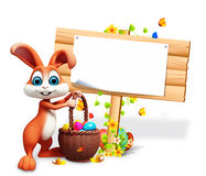 Brown bunny with big sign eggs and eggs Stock Photo