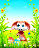 Brown Easter bunny with big colorful eggs Royalty Free Stock Photo