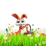 Brown Easter bunny with big eggs basket Royalty Free Stock Photography