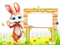 Brown easter bunny with big wooden sign Royalty Free Stock Image