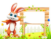 Brown easter bunny with carrot and big wooden sign. 3d rendered illustration of brown easter bunny with carrot and big wooden sign Royalty Free Stock Photo