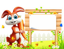Brown easter bunny with carrot in the garden with wooden sign. 3d rendered illustration of Brown easter bunny with carrot in the garden with wooden sign Stock Images