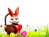 Brown Easter bunny pick up the eggs Stock Image