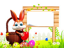 Brown Easter bunny pick up the eggs with sign Royalty Free Stock Photography