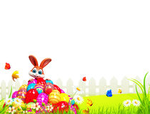 Brown easter bunny sitting on the pile of eggs Royalty Free Stock Photography