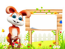 Brown easter bunny stands near sign Royalty Free Stock Photos