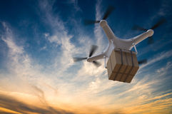 3D rendered illustration of drone flying in the sky and delivering a package at sunset.  Royalty Free Stock Image