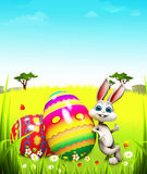 Easter bunny with big colorful eggs Stock Photo