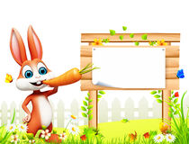 Easter bunny with big wooden sign and carrot. 3d rendered illustration of Easter bunny with big wooden sign and carrot Royalty Free Stock Image
