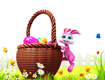 Easter bunny climbing to the big eggs basket Stock Photos