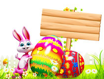 Easter bunny with colorful eggs and sign Royalty Free Stock Photos