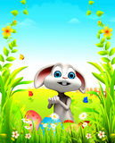 Easter bunny on the green grass with colorful eggs Royalty Free Stock Photos