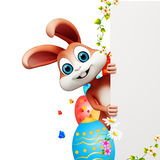 Easter bunny hiding behind sign with eggs. 3d rendered illustration of Easter bunny hiding behind sign with eggs