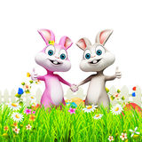 Easter bunny inside the garden with eggs Royalty Free Stock Images