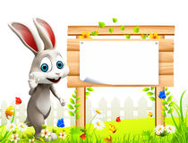 Easter bunny with wooden sign and flowers Stock Photos