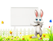 Gray bunny pointing towards big white sign Stock Photos