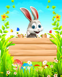 Gray Easter bunny with big sign Royalty Free Stock Images