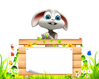 Gray Easter bunny with big sign on green grass Stock Photo