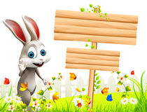 Gray Easter bunny with big wooden sign Royalty Free Stock Photography