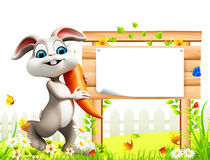 Gray easter bunny with carrot Royalty Free Stock Photo