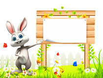 Gray easter bunny pointing towards wooden sign. 3d rendered illustration of Gray easter bunny with carrot on flowers Stock Images