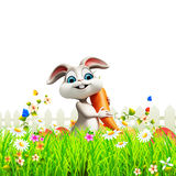 Gray easter bunny with carrot in garden. 3d rendered illustration of Gray easter bunny with carrot in garden Stock Photo