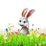 Gray Easter bunny with eggs in garden Royalty Free Stock Photos