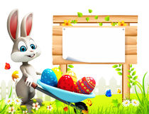 Gray easter bunny with eggs trolley and sign Royalty Free Stock Photos