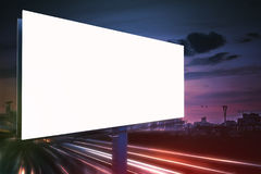 3D rendered illustration of large billboard at night. Light trails in background Stock Photography