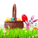 Pink bunny dropping eggs into basket Royalty Free Stock Photo
