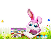 Pink bunny reading books in the garden Stock Image