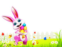 Pink Easter bunny dancing with eggs Stock Photo