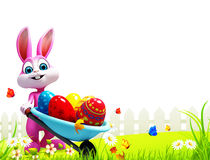 Pink easter bunny with eggs trolley Royalty Free Stock Photo