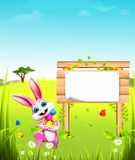 Pink easter bunny with sign and eggs Royalty Free Stock Photos