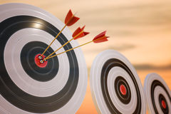 3D rendered illustration of target with arrows at sunset.  Stock Photo