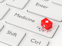 3d rendered keyboard with first aid kit and pills Stock Photo