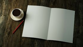 3d rendered mockup bi-fold double folded vertical blank A4 paper sheet, brochure, leaflet, magazine with a red pencil. 3d render mockup bi-fold double folded Royalty Free Stock Images